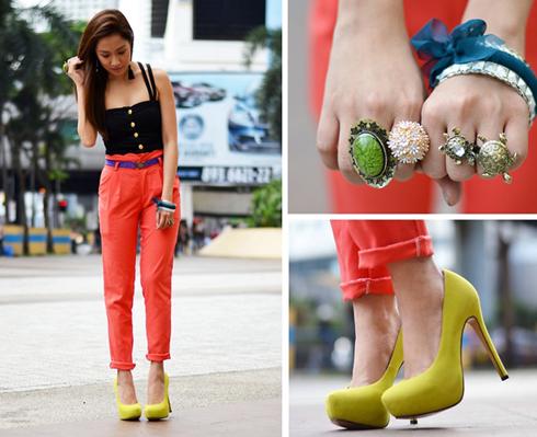 Diện quần xắn gấu màu cam, cô gái nhấn nhá thêm với thắt lưng tím, giày vàng và những phụ kiện thú vị, bắt mắt.