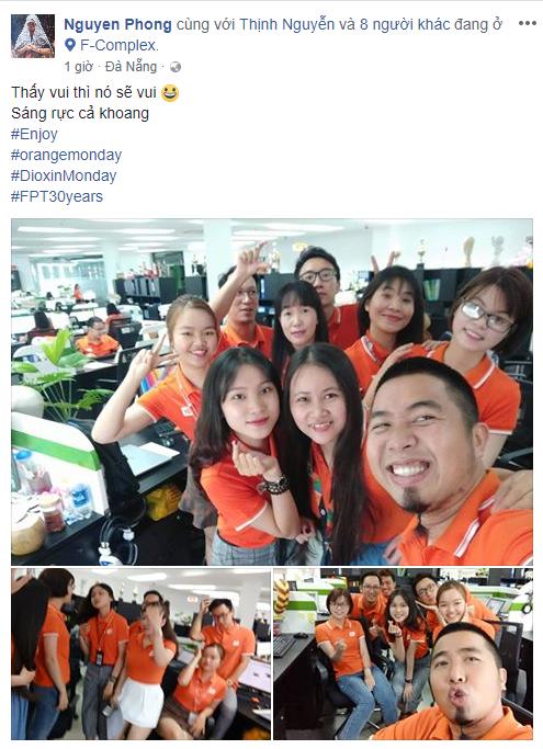 Các CBNV FPT Software Đà Nẵng hồ hởi chụp ảnh khoe sắc cam trên Facebook.