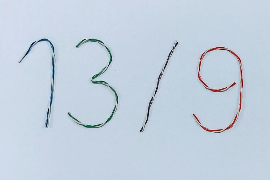 Anh Trương Hải Lâm - FPT IS SRV HCM sử dụng những cọng cáp để tạo hình 13/9.