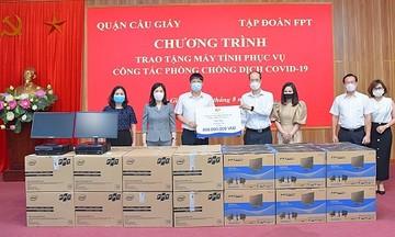 FPT tặng máy tính cùng quận Cầu Giấy chống dịch Covid-19
